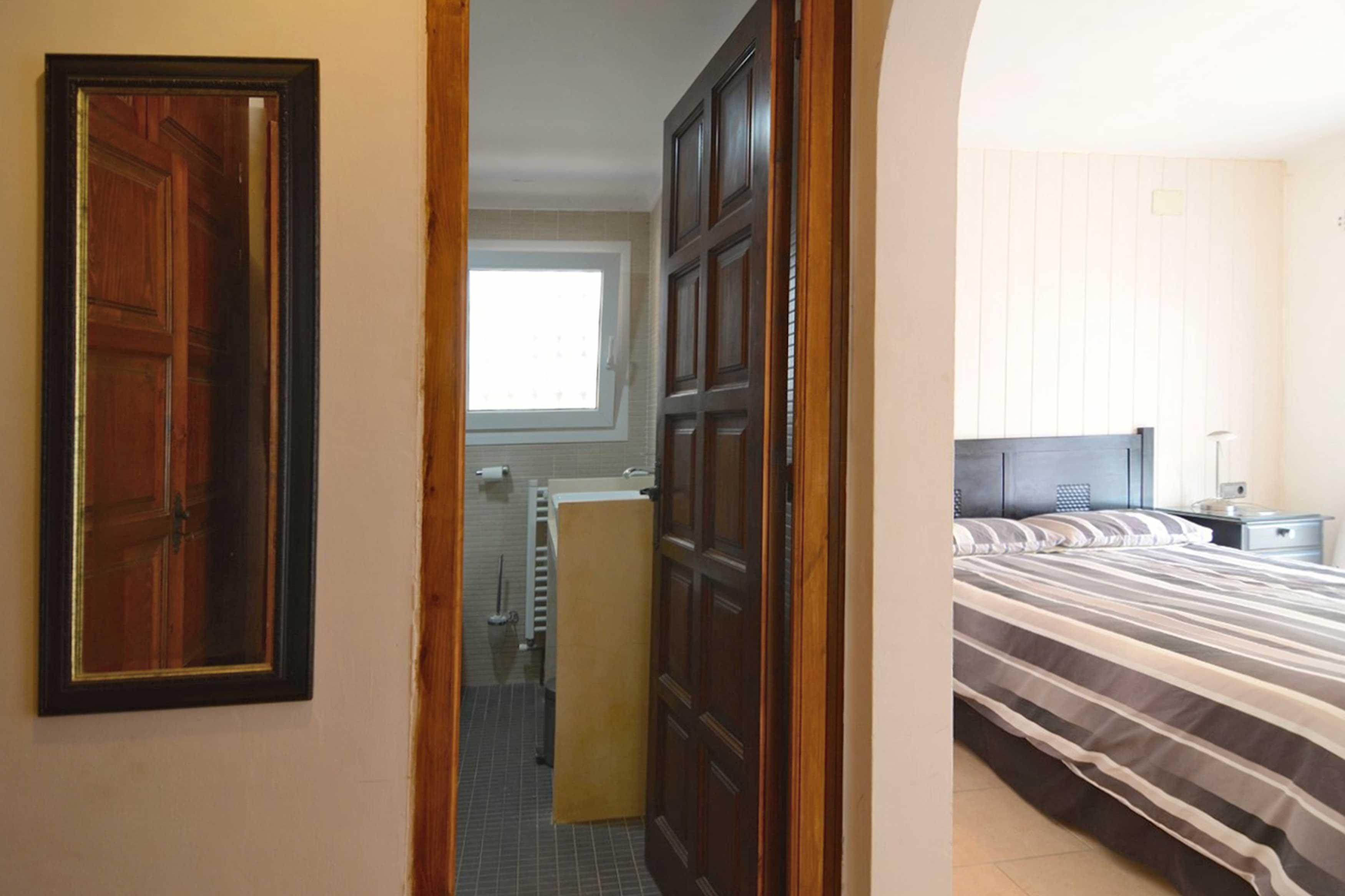 Slaapkamer met badkamer Villa Buckingham